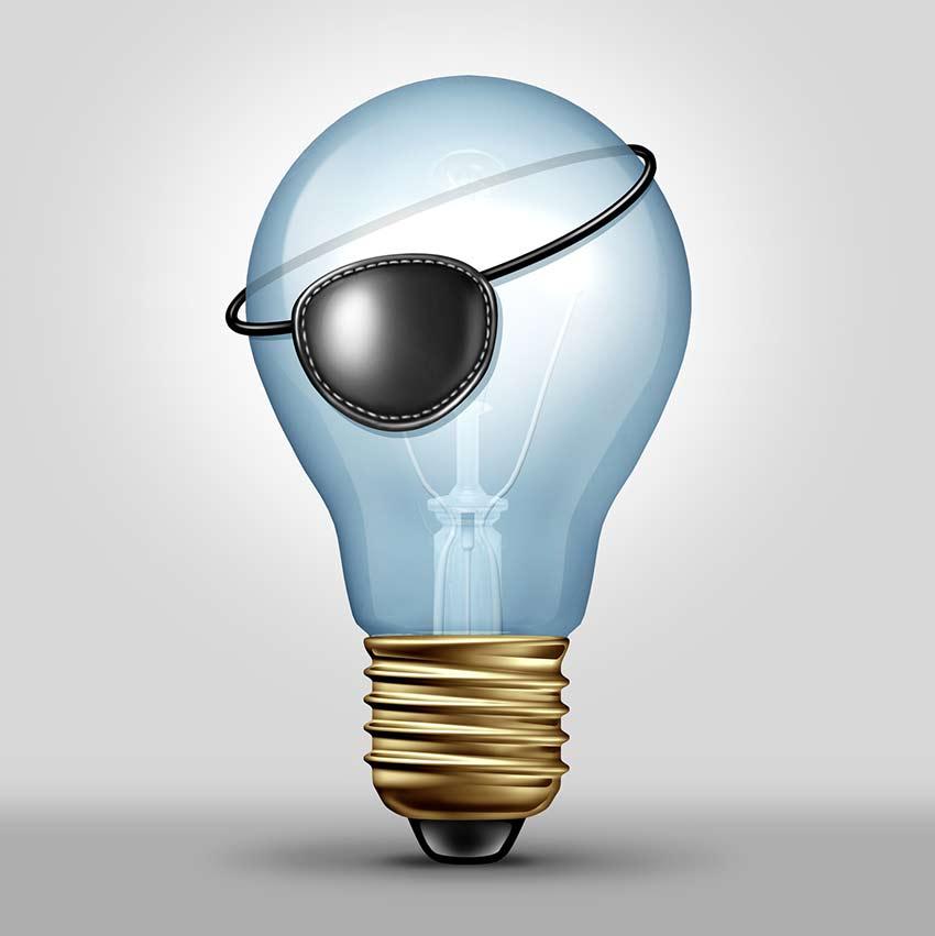Illustration of a lightbulb with pirate eye patch symbolizing idea theft
